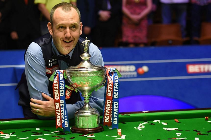 Mark Williams (pictured) celebrates with his trophy after beating John Higgins in the World Championship Snooker final match in Sheffield, England, on May 7, 2018.