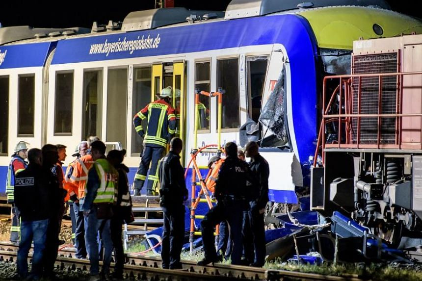 Firefighters and rescuers workers at the scene of the train accident in Aichach, Germany, that killed two people and left several others injured on May 7, 2018.