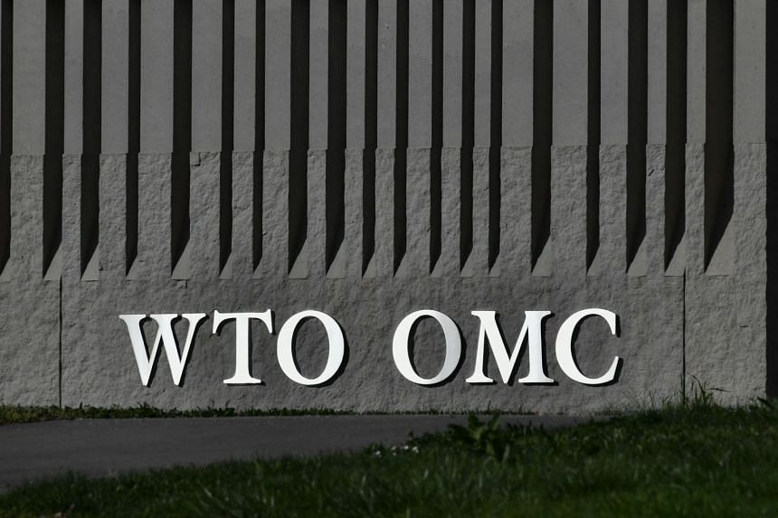 A sign of the World Trade Organisation is seen at the organisation headquarters in Geneva.