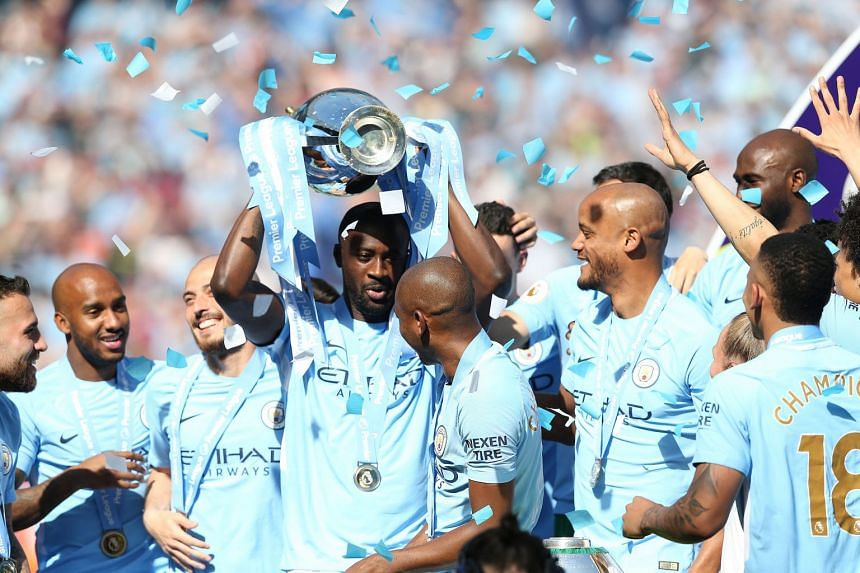 Toure lifting the Premier League trophy at the Etihad Stadium in Manchester, Britain, May 6, 2018.
