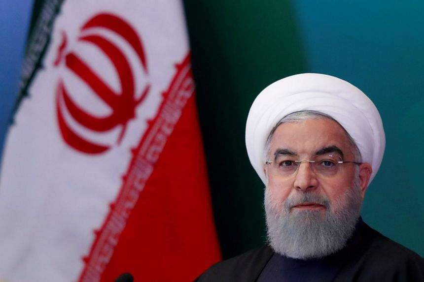 Rouhani (above) said Iran would remain committed to the multinational nuclear deal.