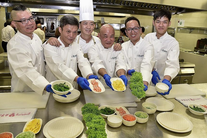 HCSA Academy Culinary Training Centre's head trainer, Chef Ng Boon Kiong (third from left), with the five trainees who graduated yesterday. They are (from left) Mr Seow Boon Phong, Mr Lee Kok Pheng, Mr Colin Chan, Mr Dwight Soriano and Mr Marcus Loh