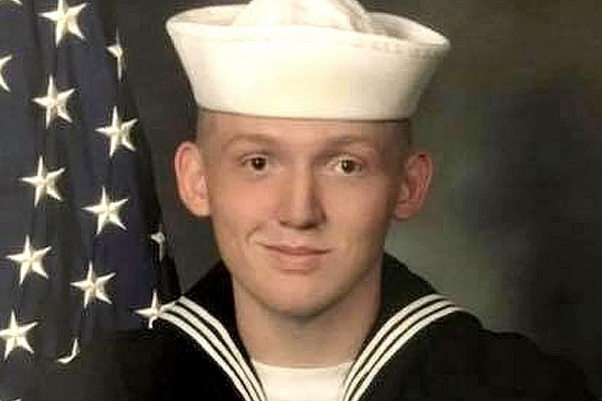 US seaman Seth Woods, seen here in civilian clothes and uniform in a Facebook post by his sister. He is said to have been last seen in a 7-Eleven store before he went missing.