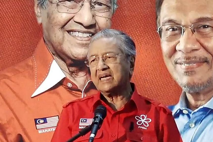 """Former prime minister Mahathir Mohamad speaking in Kuah, Langkawi, yesterday. In his speech, which was streamed live on Facebook, he urged people to vote, saying """"only our votes can save our country""""."""