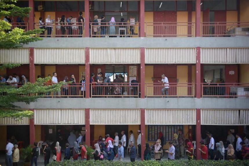 Voters queueing at Sekolah Menengah Kebangsaan Puteri Wilayah on May 9, 2018.