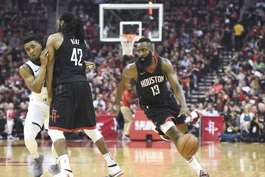 Houston Rockets guard James Harden (13) dribbles as centre Nene Hilario (42) sets a pick against Utah Jazz guard Raul Neto (25) in the second half in game five of the second round of the 2018 NBA Playoffs at Toyota Centre on May 9, 2018.