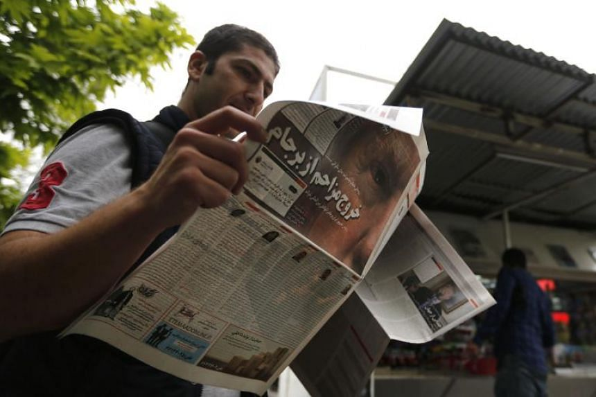 An Iranian man checks a newspaper in Teheran on May 9, 2018, a day after US President Donald Trump announced the US is pulling out of the nuclear deal.