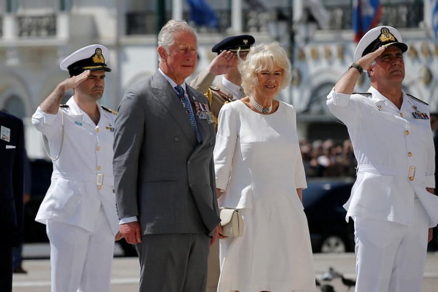 Britain's Prince Charles and his wife Britain's Camilla, Duchess of Cornwall attend a wreath laying ceremony at the Tomb of the Unknown Soldier in Athens, Greece, on May 9, 2018.