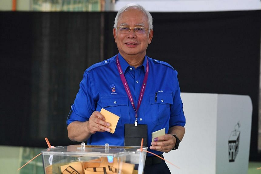 Malaysian Prime Minister Najib Razak placing his vote at a polling station in Pekan, on May 9, 2018.