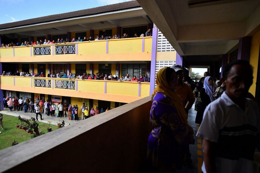People queueing to vote at SMK Pasir Gudang 3, in Johor, Malaysia, on May 9, 2018.