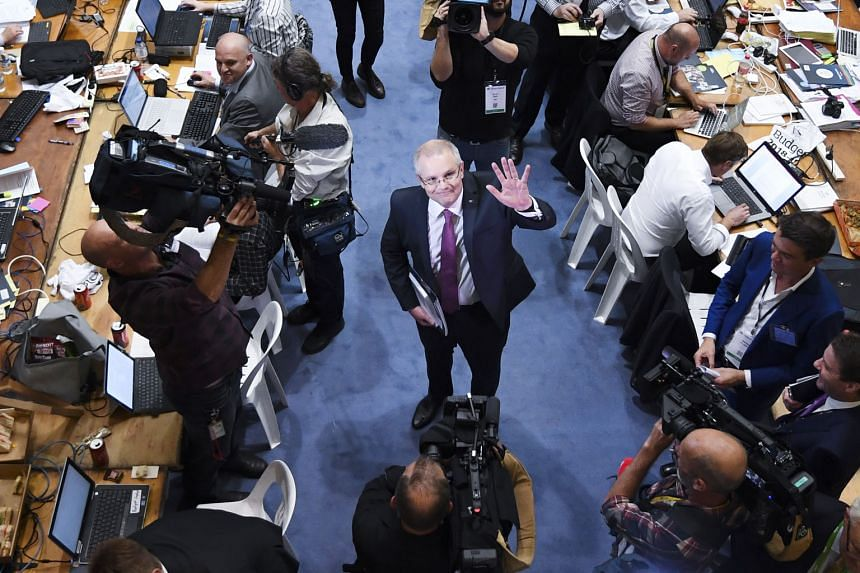 """Australian Treasurer Scott Morrison at Parliament House in Canberra yesterday. Mr Morrison said the nation's fortunes had """"turned around"""", with the national coffers receiving a surprising 6.6 per cent boost due to the growing economy and higher resou"""