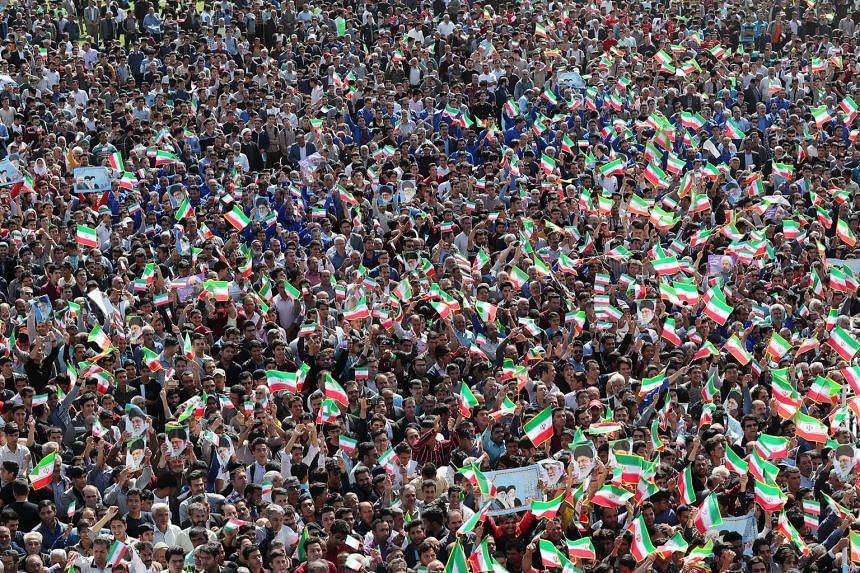 Crowds listening to Iranian President Hassan Rouhani in the city of Sabzevar, in north-western Iran, on Sunday. Mr Rouhani has said that Iran wants the JCPOA or nothing at all.