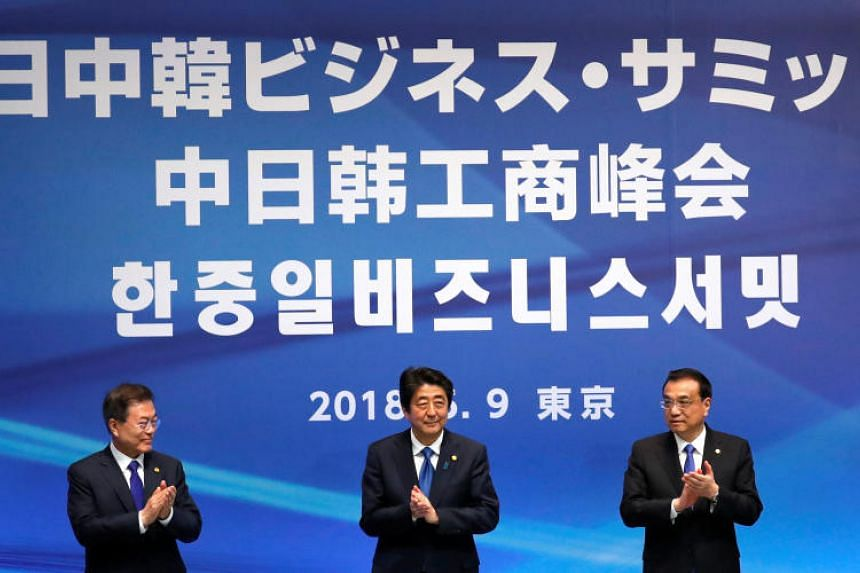 South Korea's President Moon Jae In, Japan's Prime Minister Shinzo Abe and Chinese Premier Li Keqiang at a three-way summit in Tokyo, Japan on May 9, 2018.
