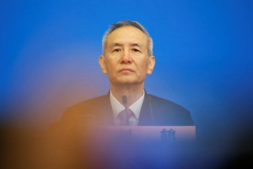 Chinese Vice-Premier Liu He attends a news conference following the closing session of the National People's Congress  at the Great Hall of the People in Beijing on March 20, 2018.