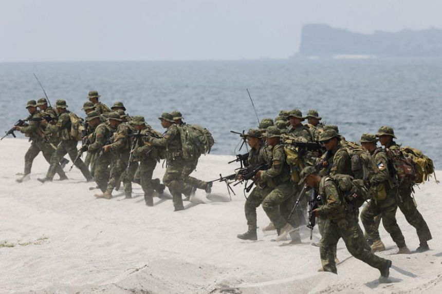 Philippine Marines rush to shore during an amphibious landing exercise with US counterparts on a beach on the coast of the Naval Education and Training Command in Zambales Province, northwest of Manila, Philippines, on May 9, 2018.