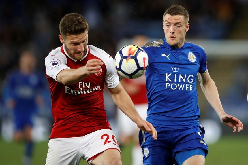 Arsenal's Shkodran Mustafi in action with Leicester City's Jamie Vardy.