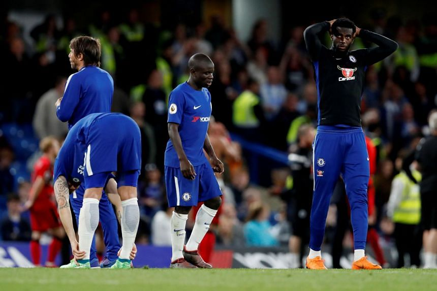 Chelsea's N'Golo Kante and team mates with manager Antonio Conte look dejected after the match.
