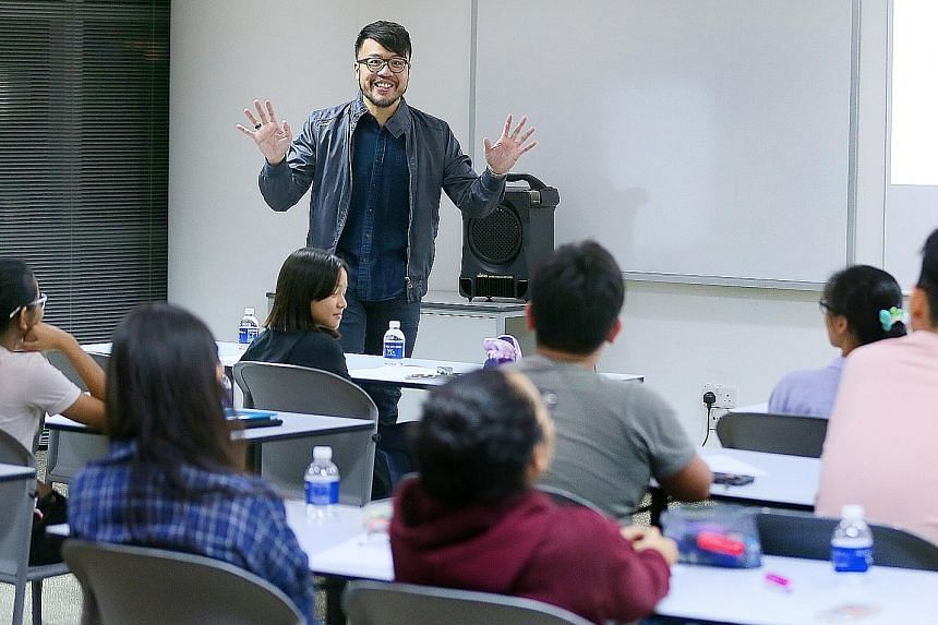 Course trainer Darrell Tan running the ST English Class on Monday. Besides teaching fundamental comprehension, grammar and vocabulary skills, the course is designed to hone students' higher-order thinking skills by getting them to discuss and make se