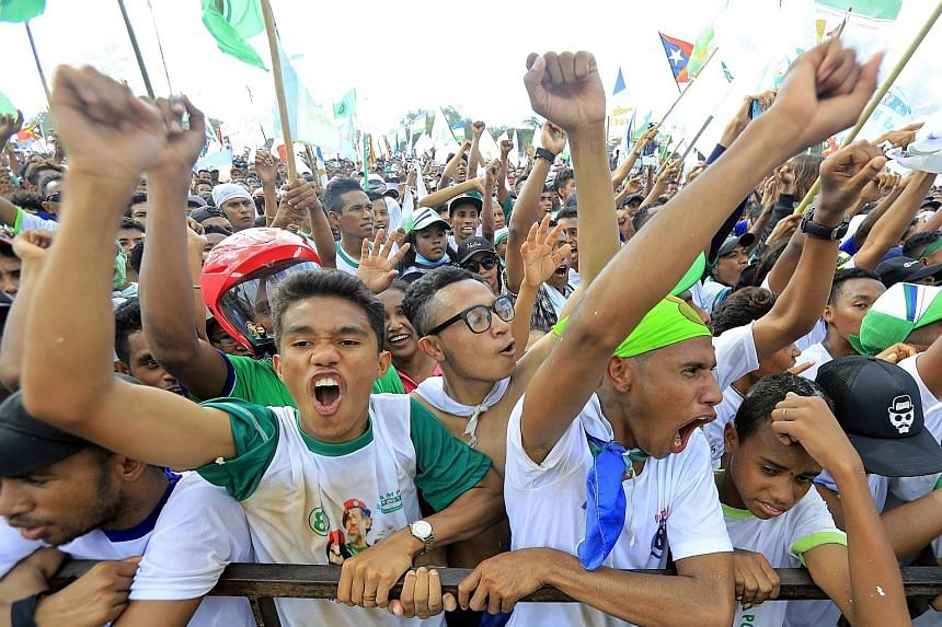 Supporters of Parliamentary Majority Alliance - comprising the National Congress for Timorese Reconstruction, People's Liberation Party and youth-based Khunto party - at a campaign rally in Tasitolu, Dili, in Timor-Leste, on Tuesday.