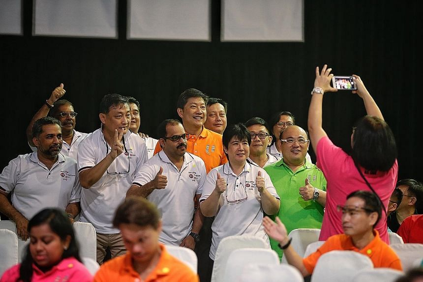 Mr Ng Chee Meng (in orange) having a photo taken with participants during this year's May Day Rally at D'Marquee. Mr Ng (in red top) joining members of the National Taxi Association for lo hei during a visit to Changi Airport on Feb 16, the first day