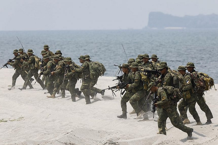 Filipino marines during an amphibious landing exercise with their US counterparts. The number of troops taking part in the drills has increased by almost half from last year, to 8,000.