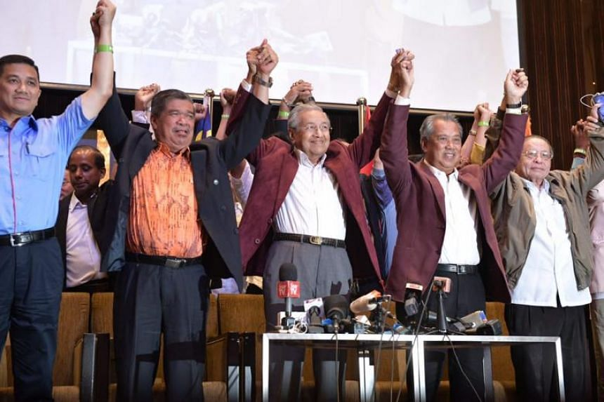 Former prime minister Mahathir Mohamad and members of his team addressing the media at the Sheraton Hotel in Petaling Jaya in the early hours of May 10, 2018.
