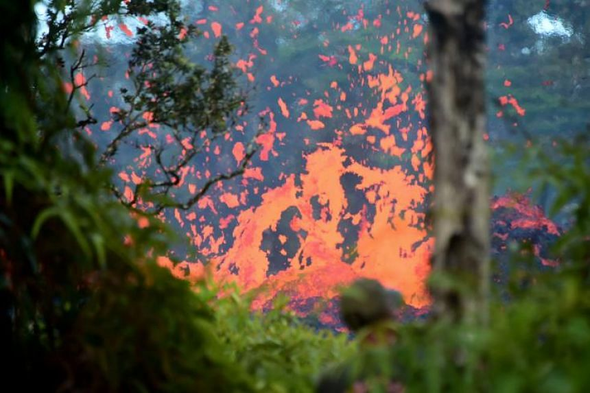 Lava is seen spewing from a fissure in the Leilani Estates subdivision on Hawaii's Big Island on May 4, 2018.