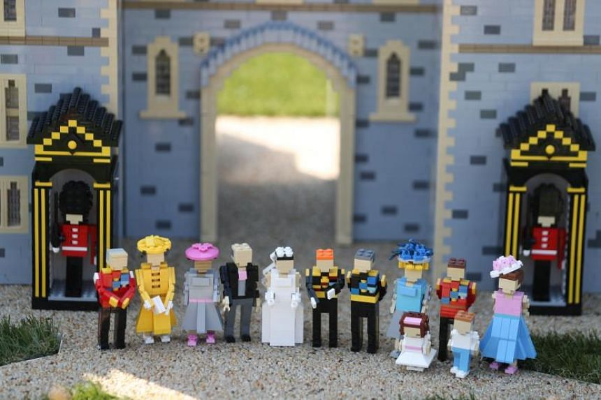 A Lego display shows Britain's Prince Harry and bride-to-be US actress Meghan Markle standing with their families on their wedding day outside a Lego-brick model of Windsor Castle at Legoland in Windsor on May 8, 2018.
