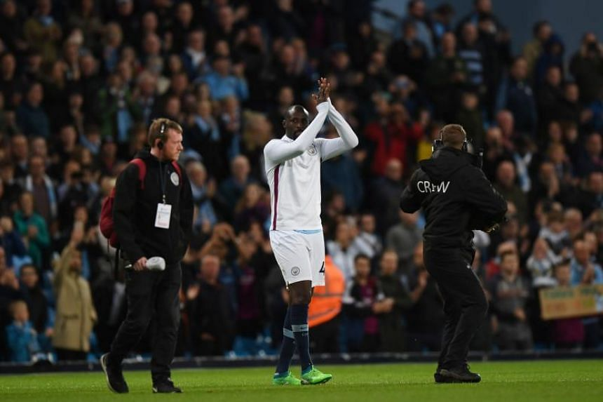 Manchester City's midfielder Yaya Toure applauds fans after playing for the last time for City in the English Premier League football match between Manchester City and Brighton and Hove Albion at the Etihad Stadium in Manchester, north west England,