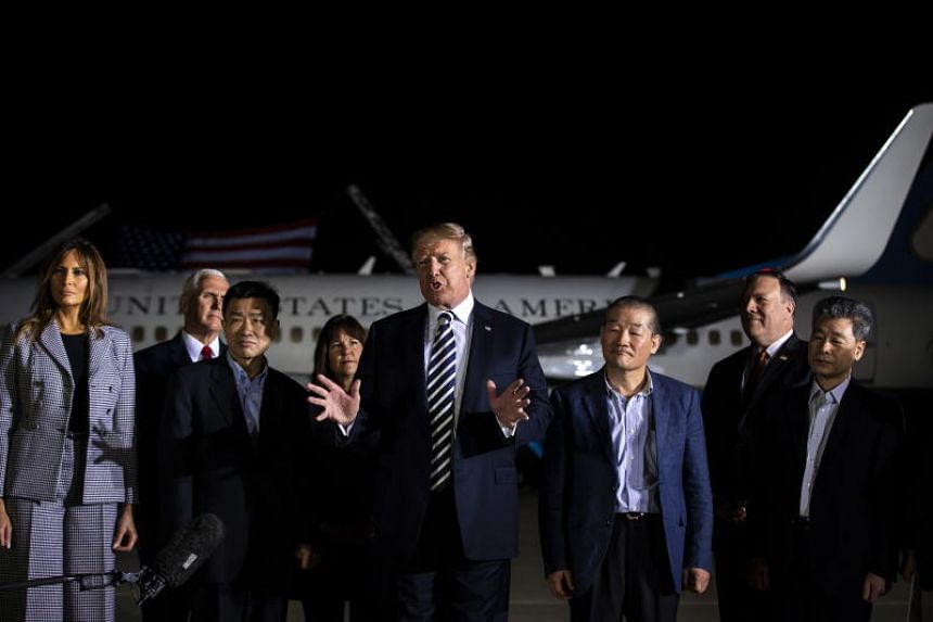 US President Donald Trump speaks beside three American detainees after their arrival from North Korea at Joint Base Andrews, Maryland, on May 10, 2018.