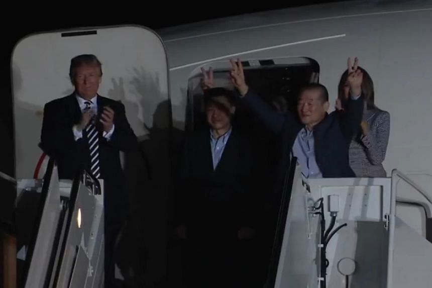 US President Donald Trump welcomes three American prisoners released by North Korea at Joint Base Andrews, Maryland, on May 10, 2018.