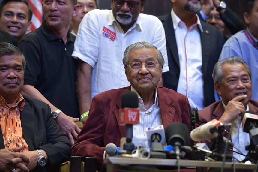 Former prime minister Mahathir Mohamad addressing the media at the Sheraton Hotel in Petaling Jaya in the early hours of May 10, 2018.
