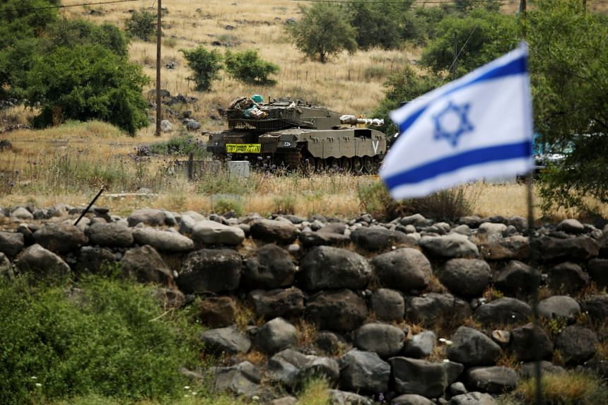 An Israeli tank near the Israeli side of the border with Syria in the Israeli-occupied Golan Heights, Israel on May 9, 2018.