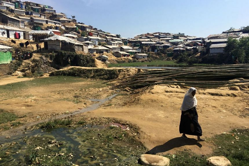 A woman walks through the Chakmakul camp for Rohingya refugees in southern Bangladesh on Feb 13, 2018.