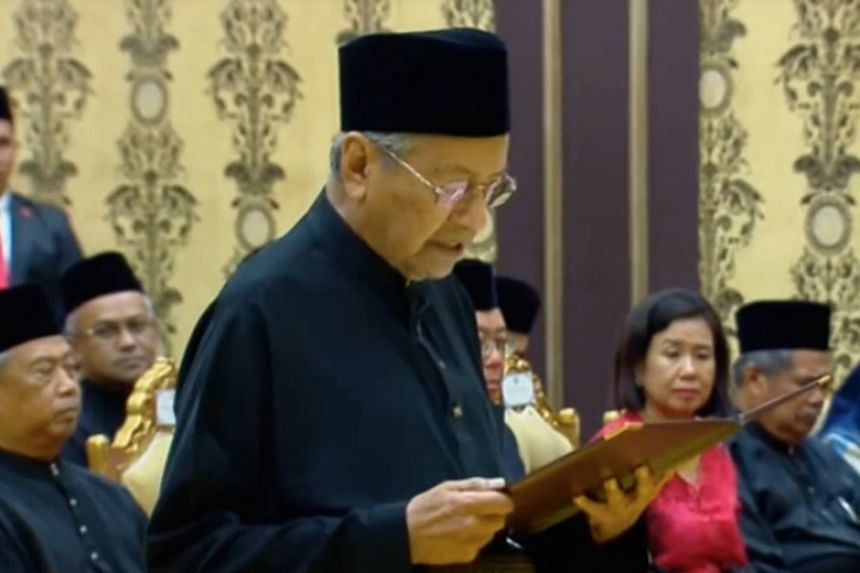 Tun Mahathir Mohamad being sworn in as Malaysia's seventh Prime Minister at the Palace on May 10, 2018.