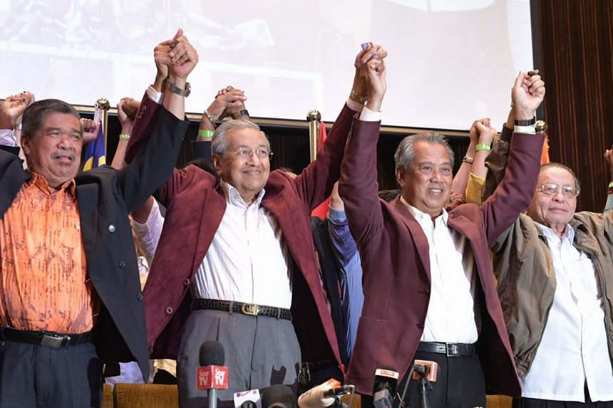 Tun Dr Mahathir Mohamad, flanked by fellow opposition leaders (from left) Mohamad Sabu, Tan Sri Muhyiddin Yassin and Mr Lim Kit Siang, after a press conference in Kuala Lumpur early this morning.