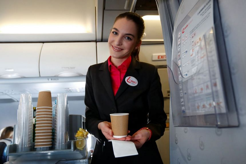 A flight attendant serving coffee aboard a plane in Germany. The survey looked at US flight attendants.