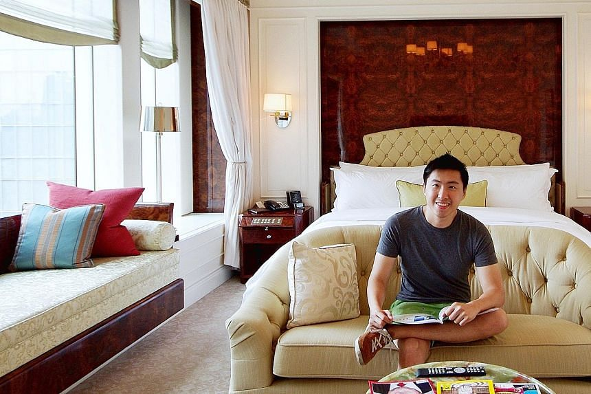 """Financial products trader Albino Chua, 33, known on Instagram as """"Bino Chua"""", in a hotel room at The St Regis Singapore in August 2015. He does not specifically look for an """"Instagrammable"""" hotel, but places great emphasis on aesthetics."""