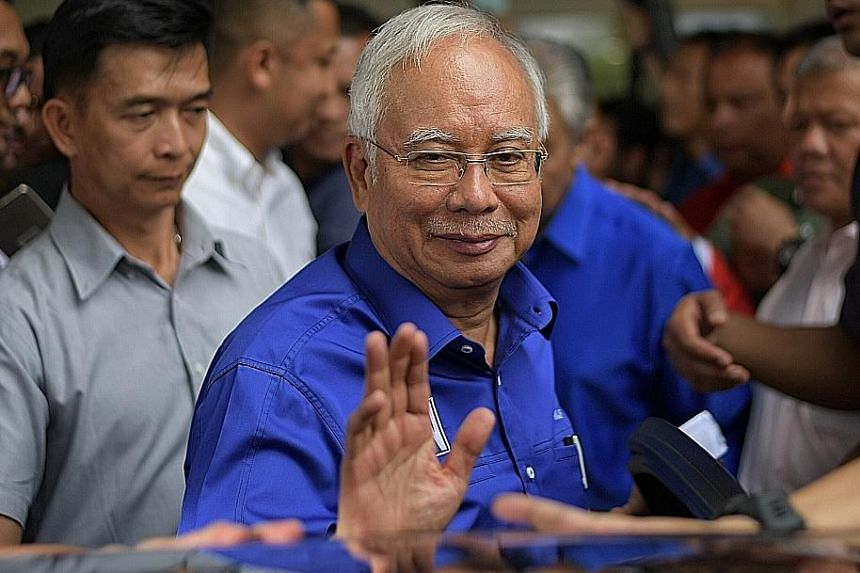 "Former premier Najib Razak said the 79 seats Barisan Nasional won would be considered as a mandate of ""great responsibility""."