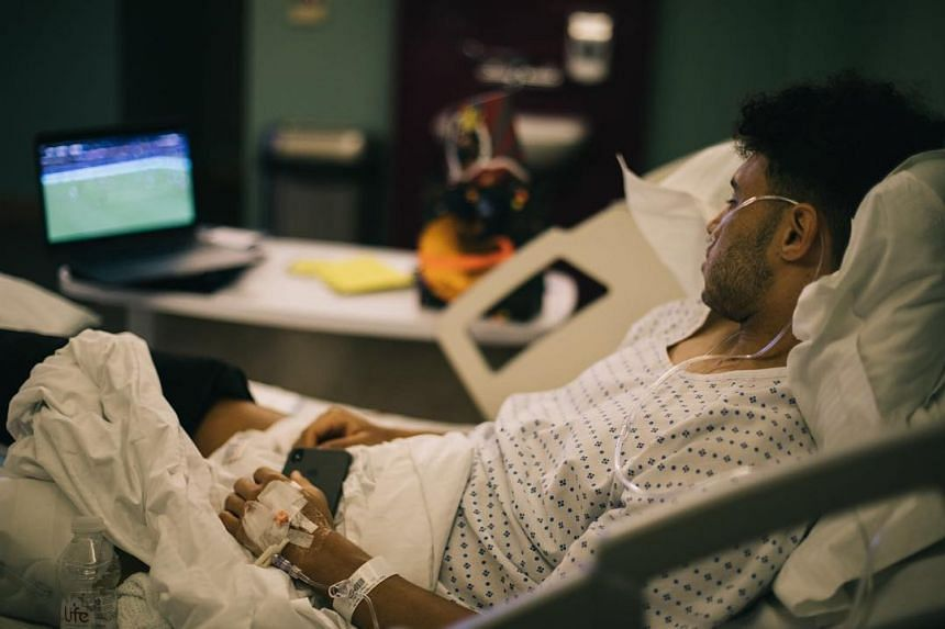 Oxlade-Chamberlain shared a photo of himself recovering from his operation in a hospital bed.