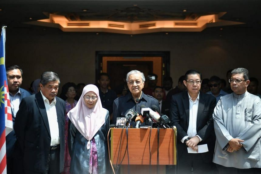 Malaysian Prime Minister Tun Dr Mahathir Mohamad (centre) speaking at a press conference after a Pakatan Harapan presidential council meeting on May 11, 2018.