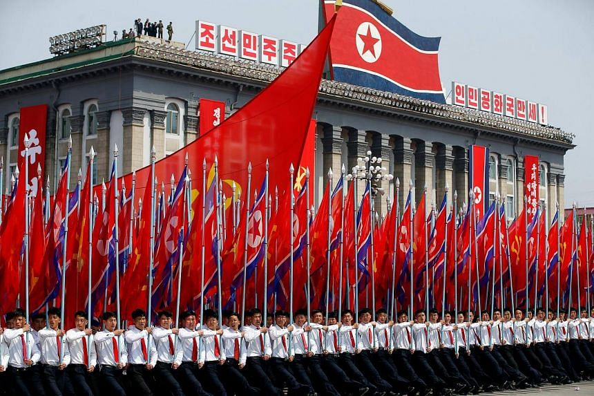 Men carrying flags during a military parade in Pyongyang, North Korea, on April 15, 2017.
