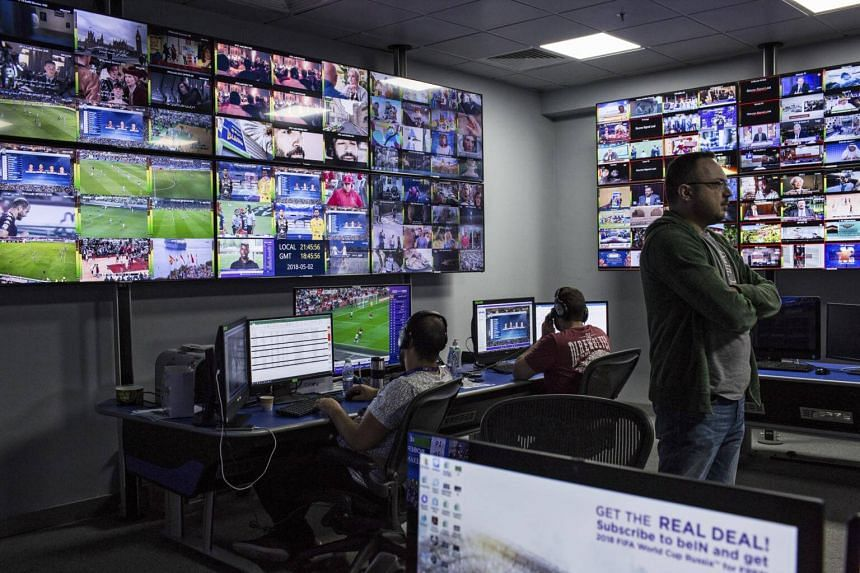 Engineers in an anti-piracy monitoring room at beIN Sports headquarters work to prevent a hacked feed of the channel from being disseminated throughout Saudi Arabia In Qatar on May 2, 2018.