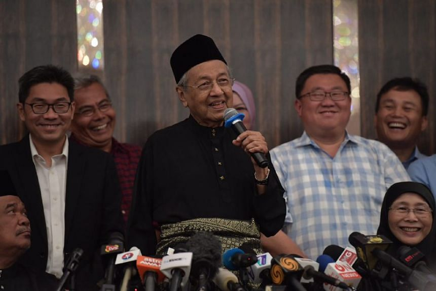 Tun Dr Mahathir Mohamad speaks at a press conference after being sworn in as Malaysia's seventh Prime Minister at the Sheraton Hotel in Petaling Jaya on May 10, 2018.