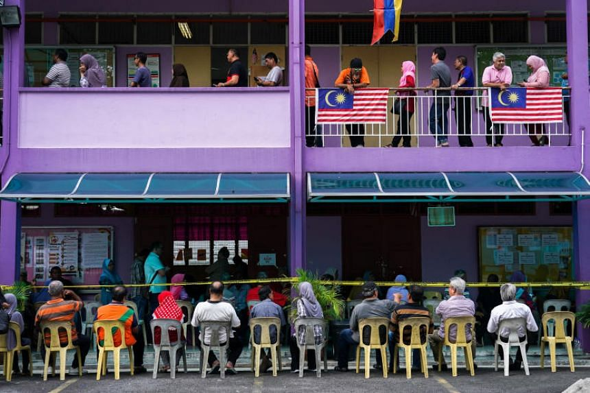 People line up to vote in Kuala Lumpur during the general election on May 9, 2018.