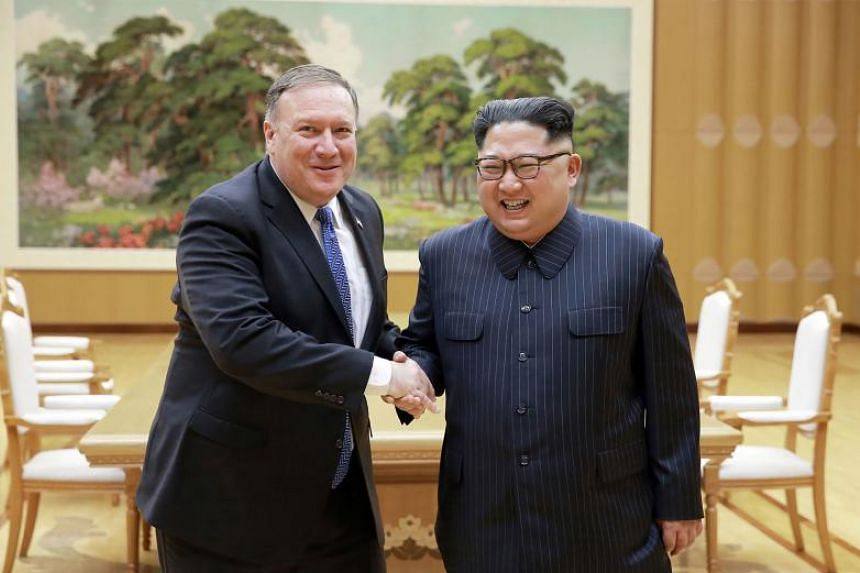 North Korean leader Kim Jong Un (right) and US Secretary of State Mike Pompeo shaking hands at the Workers' Party of Korea headquarters in Pyongyang on May 10, 2018.
