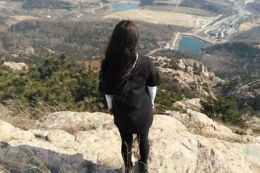 Renee Ren on Cangma Mountain in Qingdao, China. The graduate student has become a social media sensation in China after attempting to sue police for dismissing her rape report.