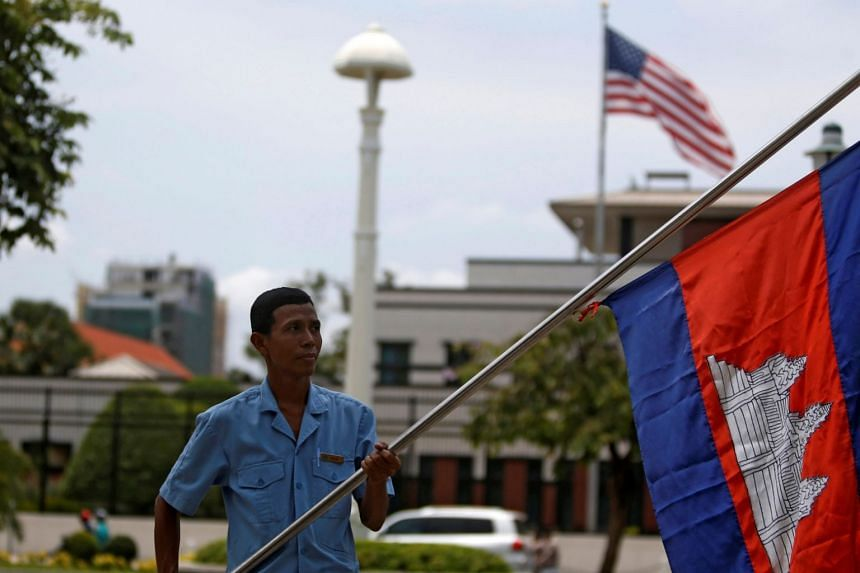 A man holding a Cambodian flag opposite the US Embassy in Phnom Penh, Cambodia, on April 13, 2018.