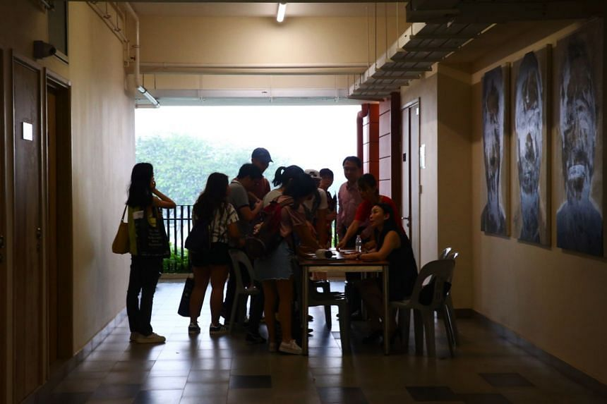 Affected Hwa Chong Institution students checking their names against a register before attending a briefing on Feb 23, 2018, about their missing exam papers.