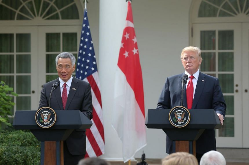 Prime Minister Lee Hsien Loong and US President Donald Trump during a joint press conference at the White House, on Oct 23, 2017. PM Lee has invited President Trump to visit Singapore in November.